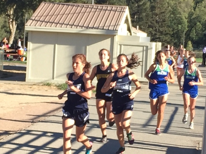 Juliette Nast of Justin-Sienna leads in the early stages of the girls race.  Grace Dailey of Branson would go on to win.